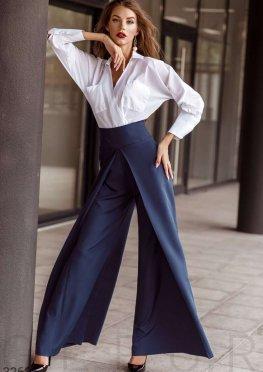 Расклешенные синие брюки
