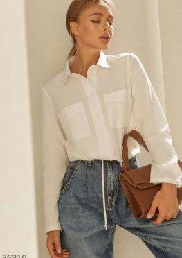 Блуза с карманами молочного оттенка