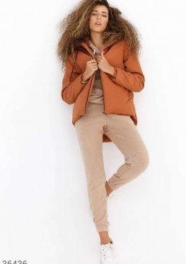 Куртка трендового оттенка с асимметрией