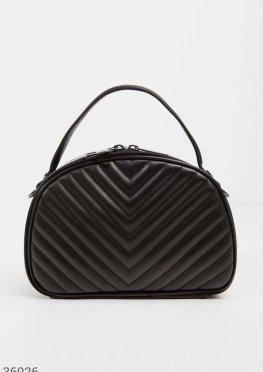 Скругленная сумка черного цвета