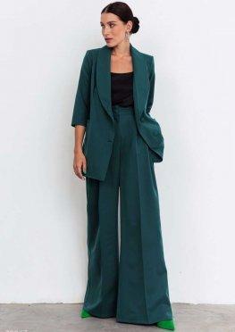 Широкие зеленые брюки