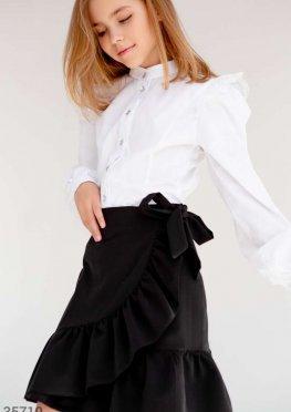 Черная юбка на запа?х с воланом
