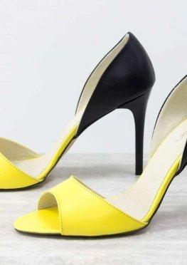 Легкие женские босоножки на шпильке, выполнены из натуральной кожи ярко-желтого и черного цвета