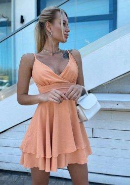 Комбинезон-платье персикового цвета