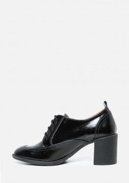 Кожаные закрытые туфли на каблуке
